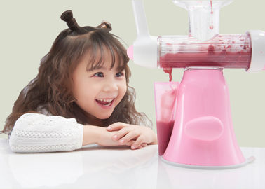 China Pink Color Portable Manual Fruit Juicer Making Juice From Fruit And Vegetables supplier